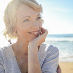 Beautiful mature woman portrait on the beach